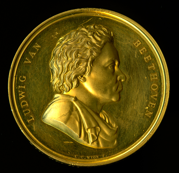 Medal:  Beethoven medal. The Royal Philharmonic Society Gold Medal presented to Sir Henry Wood, 1921. Designed by Leonard Charles Wyon.